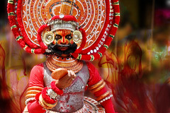 Theyyam at Onam Attahchamyam in Kerala ! (Anoop Negi) Tags: world street carnival red vacation india holiday color colour art tourism festival painting photography for photo dance holidays paint place dancing image god