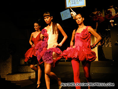 The three grand finalists in devilish red gowns