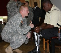 Active-duty double amputee inspires troops in ...