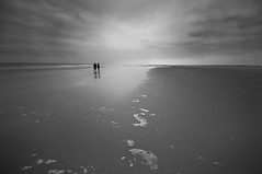 Mom and Dad (Guido Musch) Tags: longexposure sea blackandwhite bw beach water netherlands nikon zwartwit momanddad nederland zee foam lonely nothing friesland schiermonnikoog fryslan mediumexposure d300 bigbeach sigma1020 nd110 paenma guidomusch