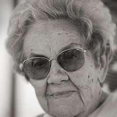 Dreaming (paul indigo) Tags: old monochrome smile lady glasses dreaming elderly 90  familygetty2010
