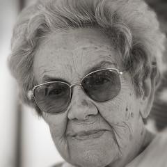Dreaming (paul indigo) Tags: old monochrome smile lady glasses dreaming elderly 90 سكس familygetty2010