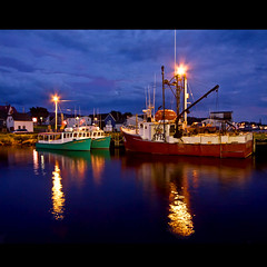 Cheticamp Harbour (melepix) Tags: travel blue red sea canada green night port square boats lights fishing novascotia harbour capebreton cabottrail cheticamp