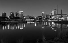 Twilight Skyline (Black & White) (roncimages) Tags: city urban blackandwhite bw reflection monochrome skyline night blackwhite al twilight birmingham dusk alabama railroadpark