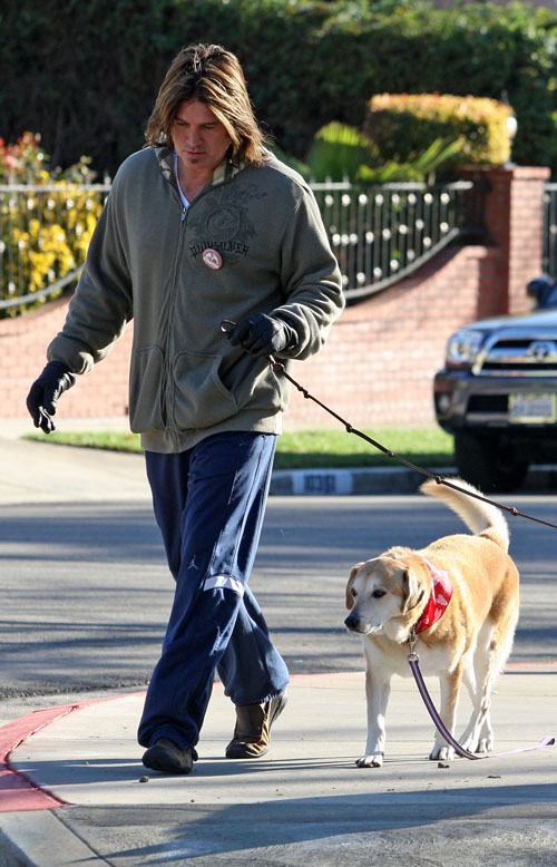 EXCLUSIVE: Billy Ray Cyrus Jogging With HIs Dogs