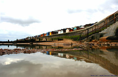 Life's a Beach!....... (law_keven) Tags: ocean sea england beach water clouds reflections seaside perspective seafront essex beachhuts atlanticocean walton waltononthenaze explore500