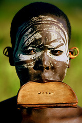 Africa - Ethiopia / Surma woman (RURO photography) Tags: voyage africa travel portrait woman tourism beautiful smile face female canon photography mujer pretty faces photos retrato african femme mulher cara reis tribal tourist bodypaint portraiture afrika lip portret surma anthropology labret reizen ethnology omo thiopien etiopia gesichter tribus scarifications omorate ethnie kartpostal fun lipplate tribalgroup enstantane etipia  etiyopya anawesomeshot journalistchronicles   flickrlovers supershot ethnograaf ethnografisch globalbackpackers lonelyplanet discoveryphoto discoverychannel discoveryexpeditions voyageursdumonde nationalgeographic inspiredelite rudiroels thegalleryoffineportrait athiopien surmawoman lipschijf