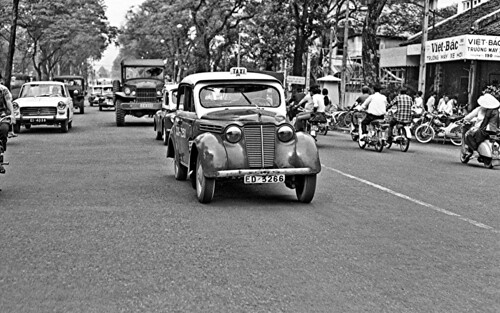 Saigon Street Traffic in 1968 by Lance & Cromwell