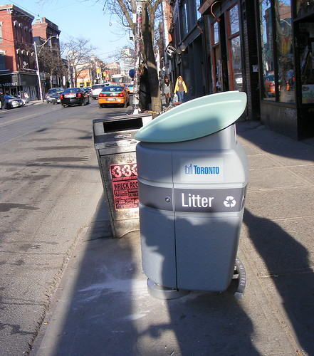 Garbage bin at S-E corner of Queen and Portland