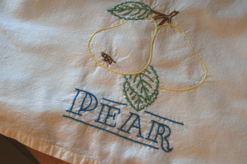 t2Embroidered teal towel, pear