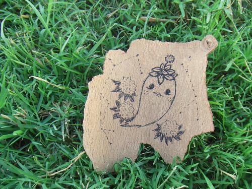 ghostie drawing on bark