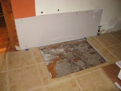 Drywall repair behind stove