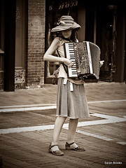 acorden (296/365) (LittleRedCera) Tags: music girl sepia burlington vermont streetperformer marketplace accordian churchstreet vignette 2009 withfriends day296 september10 project365 lightroom2 fallisalmosthere littleredcera