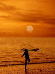 To Catch the Sun............ (aroon_kalandy) Tags: light sunset sea orange net beach nature beauty clouds creativity evening fishing waves adobephotoshop artistic action awesome fantasy greatshot dreamy impressions casting tossing naturelovers calicut beautifulshot anawesomeshot malayalikkoottam thesuperbmasterpiece sonyh50 artinoneshot saariysqualitypictures aroonkalandy