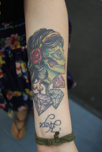 nu skool zombie gypsy tattoo on forearm