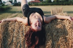 Tam on a Hay Bale (Ludovic Macioszczyk Photography) Tags: world life camera light summer portrait sky people sun plant france color art love film nature colors girl analog 35mm canon vintage hair landscape photography boot 50mm vacances countryside photo spring woods holidays shoot fuji photographie dof shine purple natural sweet ae1 no flash country tamara picture violet sunny iso 1600 photographs keep alive hay 135 sweetheart 18 bales bale fille 2009 tam bois foin argentique limousin fd photographe in ludovic pellicule crozant ludos macioszczyk