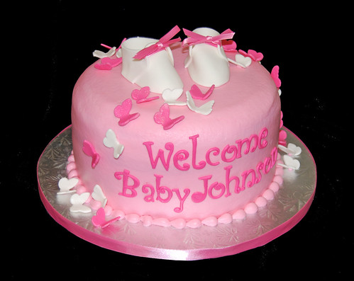 pink butterfly baby shower cake with baby booties