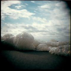 (devon cummings) Tags: ocean nyc sky 6x6 beach holga december bubbles atlantic queens foam 2008 forttilden