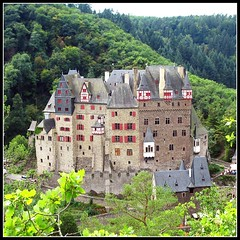 Fairytale Castle - Burg Eltz, Germany (Batikart ... handicapped ... sorry for no comments) Tags: travel red summer vacation house building tree green rot castle leaves architecture fairytale forest canon germany square landscape geotagged deutschland leaf interestingness flora holidays europa europe sommer urlaub burgeltz sightseeing scenic haus medieval eifel historic explore architektur geology grn blatt landschaft wald baum gebude vacanze burg koblenz trier 2007 reise mosel f200 mrchenhaft rheinlandpfalz moselle elz eltz geologie sehenswrdigkeit mnstermaifeld canonpowershota610 10000views wierschem rhinelandpalatinate 100faves i500 200faves fairytalecastle viewonblack 300faves holidaysvacanzeurlaub 400faves batikart elzriver 500dmgeldschein