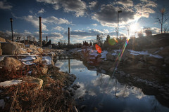 Flat Branch Park 1.29.2009 (Notley) Tags: park winter sky cloud sun snow rock clouds creek reflections rocks columbia reflect smokestack smokestacks missouri lensflare sunburst 2009 columbiamissouri flatbranch 10thavenue reflecition notley janaury ruralphotography notleyhawkins missouriphotography flatbranchpark flatbranchcreek httpwwwnotleyhawkinscom notleyhawkinsphotography