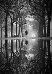 Strandvgen After Snow (Hannes R) Tags: road street city trees people bw mist man reflection tree water fog puddle mirror town blackwhite sweden stockholm path stermalm strandvgen thegalleryoffinephotography