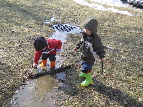 boys with sticks