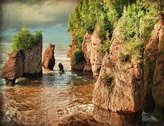 Hopewell Rocks, NB (High Tide) (sminky_pinky100 (In and Out)) Tags: travel canada texture landscape rocks scenic newbrunswick hightide hopewellrocks redmud personalbest 5photosaday atlanticprovinces bej mywinners abigfave omot cans2s eyejewel