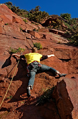 Hugging the rock? (gornabanja) Tags: uk november red nature sport yellow rock stone shirt fun outdoors scotland nikon hug edinburgh december colours d70 action climbing colourful rockclimbing lead quarry inthelead