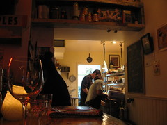 Peeking into the kitchen from the bar
