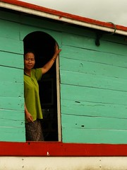 EXPECTING (robinya) Tags: portrait colors lady boat donna barca femme laos bateau colori ritratto attendant couleur mekong aspettando expecting slowboat mekongriver