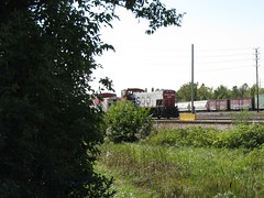 A former Soo Line EMD MP 15 yard switcher and caboose. Schiller Park Illinois. Late September 2009.