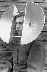 dual-head-mounted-listening-device (x-ray delta one) Tags: geek dork loser fashion style advertising ad vintageadvertising retro 1950s 1960s ear wax q tips hydrogen peroxide 1920s 1930s inventions dyi technology