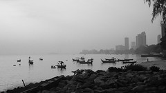 Fishing boats in early morning mist