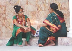 Women in Conversation (mikecogh) Tags: temple focus serious indian barefoot conversation kualalumpur marble attention hindu kl saris
