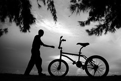 My bike (Hakimsalleh) Tags: life boy red sky blackandwhite bw man color colour men guy girl smile bike bicycle vertical horizontal kids indonesia happy blackwhite kid nikon asia peace play muslim country grow streetphotography happiness tourist journey laugh stare alive bliss staring touristspot courage riau sillhoutte grows karimun cheerfull d80 nikond80