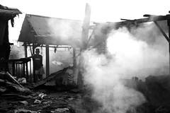 smoking life (jobarracuda) Tags: lumix smoke philippines manila worker fz50 usok tondo panasoniclumixdmcfz50 jobarracuda trabahador charcoalmaking jojopensica ulingan photokalye
