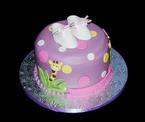 purple yellow and pink giraffe themed baby shower cake