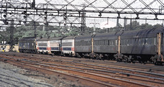 Metro North Railroad eastbound commuter train is led by FL-9's while passing through Stamford, Connecticut, August 1982 (alcomike43) Tags: old railroad electric train vintage photo slide historic commuter septa catenary conrail electrified mainline passengertrain mnr emd metronorthrailroad fl9 passengercars newhavenrailroad americanflyercars