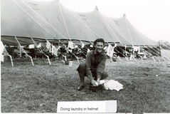 Doing laundry in a helmet (JWA Commons) Tags: woman smile women wwii helmet tent worldwarii laundry american jewish clotheslines 1944 worldwar2 militaryservice normandyfrance jewishwomen jewishamericanwomen