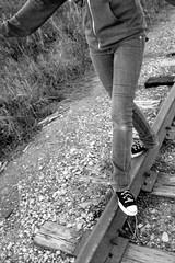 Balance Beam (Sauvium) Tags: life railroad blackandwhite white black shoes noir walk converse balance et blanc chucks balancebeam blancetnoir