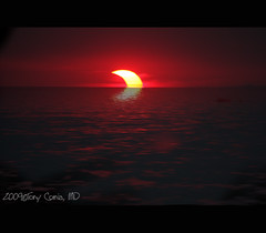 have you seen a partial eclipse of the setting sun??? (DocTony Photography) Tags: sunset sun moon canon bay solar eclipse philippines manila 100300 40d doctony omgfrensuperspectacular