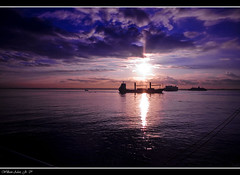 Cebu after Dawn... (rev_adan) Tags: morning blue shadow sea sun seascape port sunrise canon eos dawn philippines cebu justclouds 40d revadan