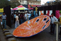 [39/365] upturned artsy umbrella (Chocolate Geek) Tags: blue red people urban orange india art colors festival umbrella project paper paint colours sunday 8 olympus daily photoaday 365 february mumbai 2009 day39 kalaghoda mws feb8 week6 photoday e510 zd yearinphotos project365 1442mm exif:exposure_bias=0ev exif:exposure=0025sec140 exif:iso_speed=400 exif:aperture=f35 project3661 2009yip camera:make=olympusimagingcorp camera:model=e510 exif:focal_length=14mm 3652009 exif:flash=ondidnotfire 20090208 meta:exif=1234300392
