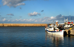 back from fishing (eLdudorino) Tags: blue sea sky cloud white fish reflection water colors clouds marina reflections grey pier boat still fishing fisherman colours fishermen harbour hellas olympus calm greece crete 1001nights fishingboat stillness chania  ellada oldharbour calmwater kriti calmsea   canea platinumphoto mallmixstaraward olympusu820