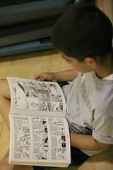 my son and his favorite pastime (mush_pvrmc) Tags: reading photochallenge 2009challenge86