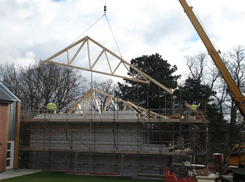 The roof trusses being lifted into place at the Tarmac Homes site.