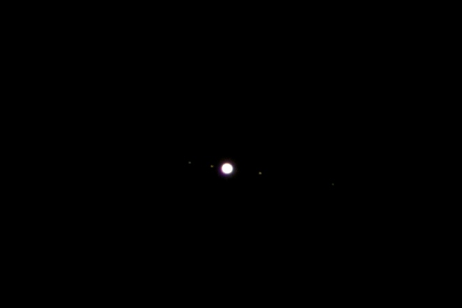 Jupiter with the Galilean Moons - from left to right Europa, Io, Ganymede and Calisto
