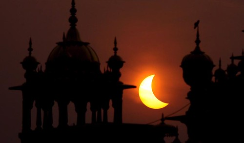 Photo: Solar eclipse seen at Golden Temple