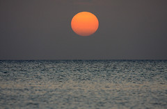 Sunset off Seven Mile Beach (Don McDougall) Tags: sunset sea sun water islands caribbean cayman caymanislands grandcayman sevenmilebeach mcdougall sunsetsandsunrisesgold donmcdougall