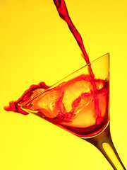 Red Splash (david.kittos) Tags: red stilllife macro glass yellow martini splash liquid strobist lightscience strobistincyprus